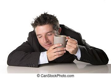 sleepy addict businessman holding take away coffee in...