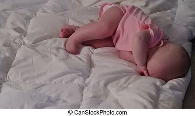 Sleepy Baby Girl Rubs Her Eyes