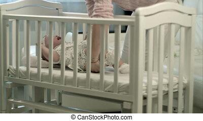 Sleepy baby in the crib