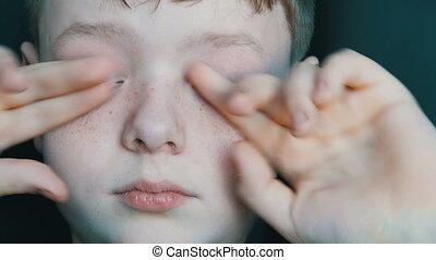 Sleepy blond boy teen rub with hands the eyes - Sleepy blond...