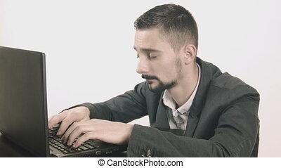 Sleepy businessman typing