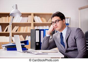 Sleepy businessman working in office