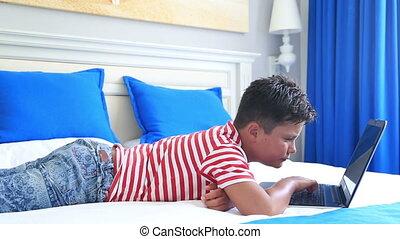 Sleepy child using laptop computer