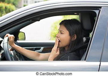 Closeup portrait tired young attractive woman with short attention span, driving her car after long hours trip, yawning at wheel, isolated outside background. Sleep deprivation