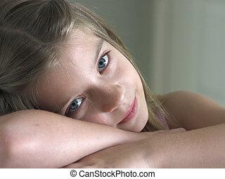 Sleepy Eyes - a pretty little girl resting her head on her ...