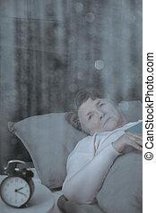 Sleepy grandmother in bed