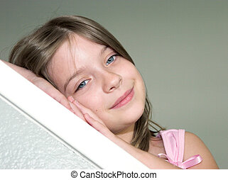 Sleepy Head - A little girl resting her head on her hands ...