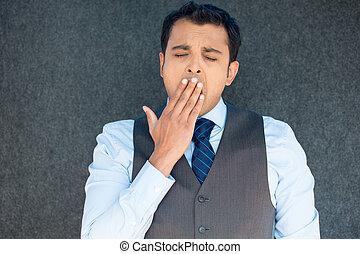 Sleepy man yawning