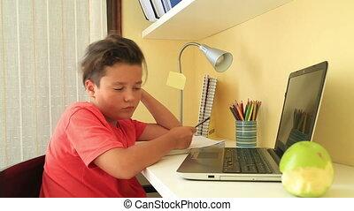 Sleepy student falling asleep on a desk - Tired schoolboy...