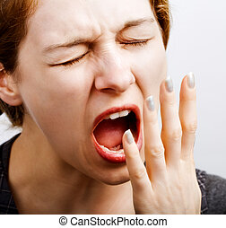 Sleepy tired woman making a big yawn - Portrait of sleepy...