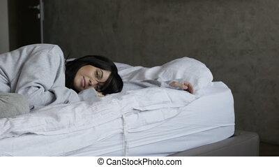 Sleepy woman on bed