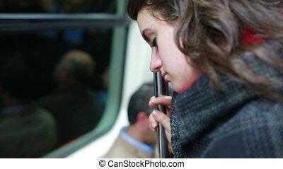 Sleepy Woman travelling inside metro