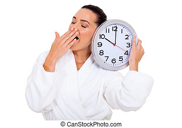 sleepy woman yawning - sleepy woman with a clock yawning...