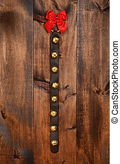 sleigh bells with red bow