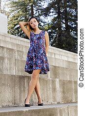 Slender Asian American Woman Standing Dress