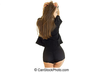 slender beautiful lady in black Bodie turned her back to the...