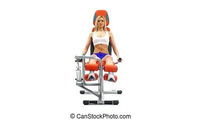 Slender blonde doing exercises on trainer