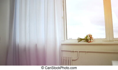cute girl comes to window curtains pushes looks into the camera and smiles