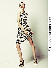 Slender Elegant Female in Contemporary Stylish Dress. Summertime Design. Series of photos
