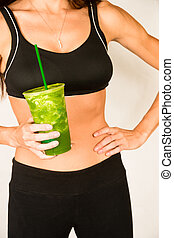 Woman holds Green Fruit Smoothie Waist Level Showing Healthy Slender Body