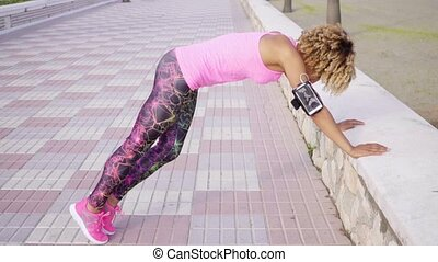 Slender fit toned young woman exercising - Slender fit toned...