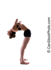 Slender flexible gymnast posing in studio