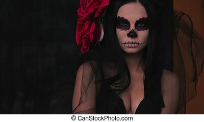 Slender girl in a translucent shawl, body art skeleton for...