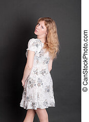 slender girl in white dress