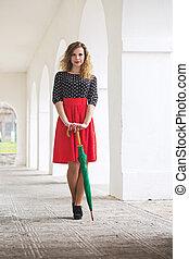 slender girl with an umbrella