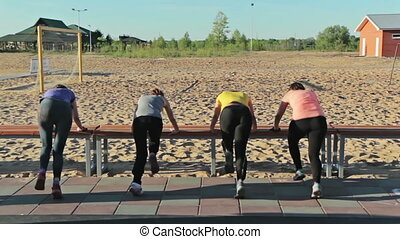 Slender girls jogging in place, in workout