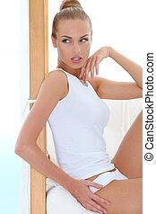 Slender seductive blond relaxing in her underwear