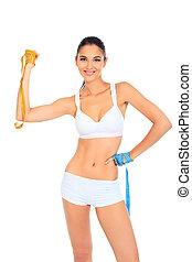 slender - Slender woman measuring her waist. Diet, healthy...