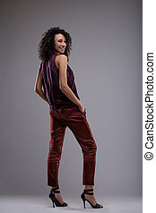 Slender stylish woman looking over her shoulder