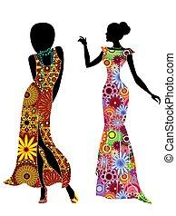 Slender stylish women in long ethnic dresses