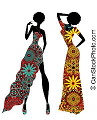 Slender stylish women in ornate ethnic long dresses