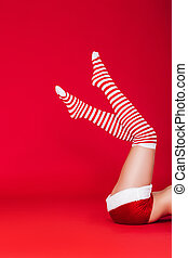 woman legs in striped Christmas stockings