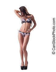 Slender woman posing in beautiful erotic lingerie