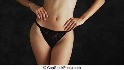 Slender woman wearing a lacey thong