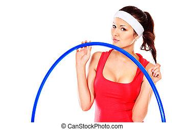 hula hoop - Slender young woman in sportswear making...