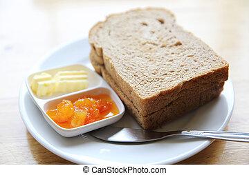 Slice bread with orange jam