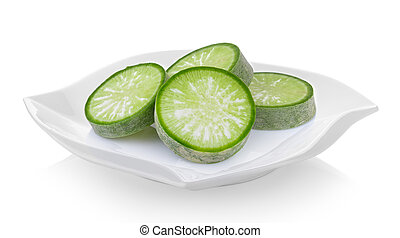 slice green radish in a plate on white background