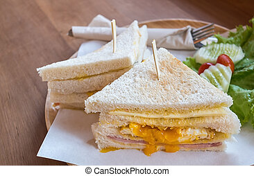 slice ham cheese egg sandwich breakfast with fresh vegetable