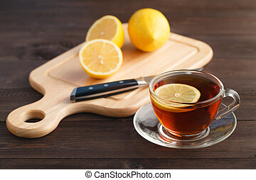 slice lemon on wood chopping board with background, close up