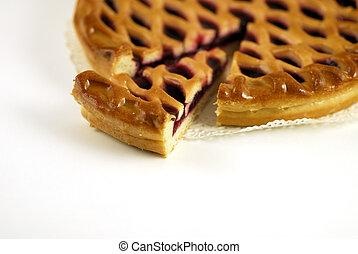 Slice of a cherry pie on a white background