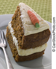 Slice Of American Carrot Cake On A Plate With A Fork