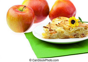 slice of apple pie apple and a flower isolated on white