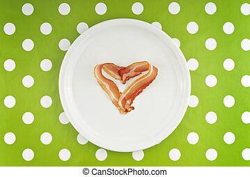 Slice of bacon on white plate