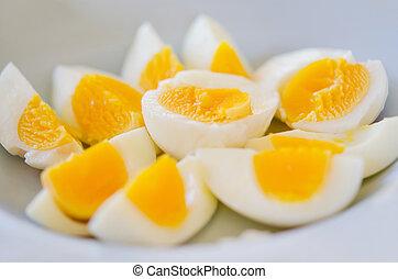 slice of boiled eggs on plate .