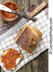 Slice of bread smeared with chutney