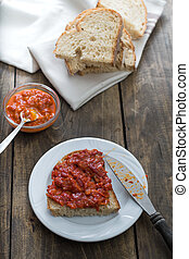 Slice of bread smeared with homemade chutney